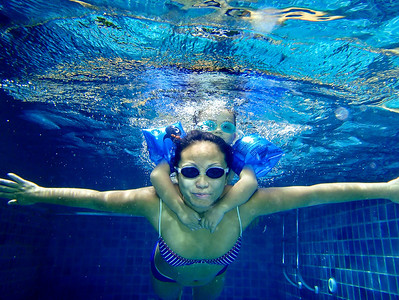"""Deep Blue"" - Sat 6 Sep  Nice to be home for the whole weekend (as last two weekends have been short due to traveling), and that means at least a few hours in the pool with the family. They are now both much more confident in the water,and spend equal time above and below the surface.  Here the waterproof Olympus 1030SW comes very handy - highly recommended!! (too bad here that the picture is not wide enough, should have had both hands in it, but as i can not look under water, it's all ""hope for the best"" when pressing the shutter)"